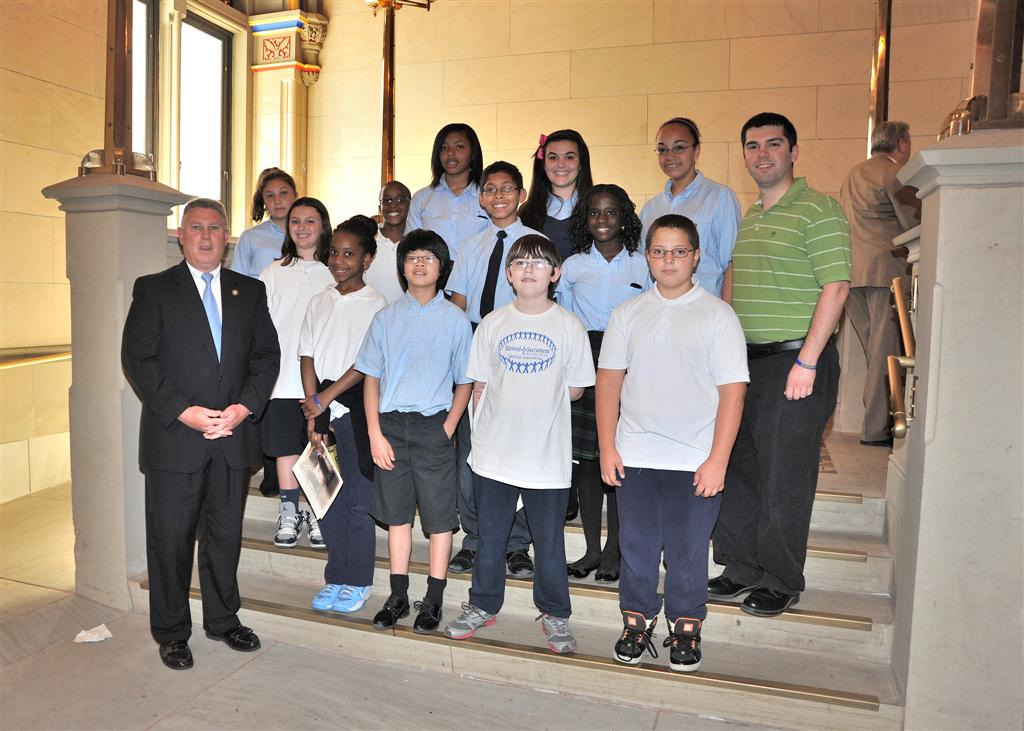 Assemblymember McDonald welcomes Blessed Sacrament to the Assembly Chambers.