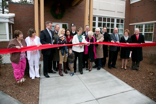 Assemblyman Phil Steck joins in the ribbon cutting of the Bellevue Women's Center's new Breast and Heart Health Center.