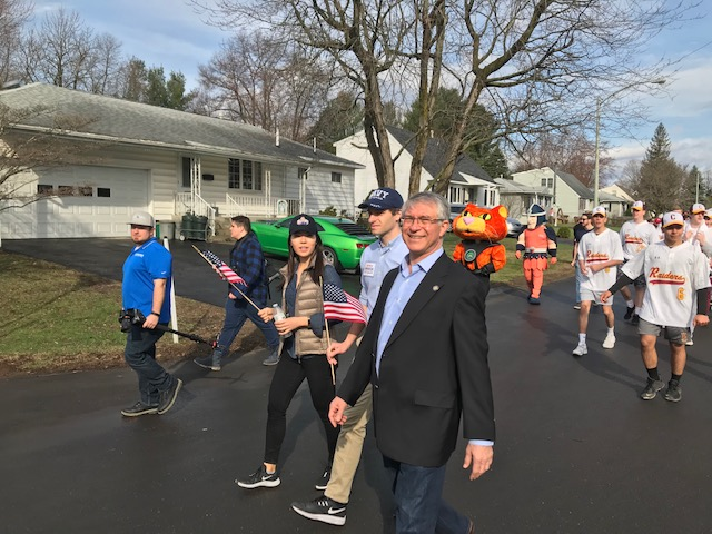 Assemblymember Phil Steck walks in the Colonie Little League Opening Day Parade