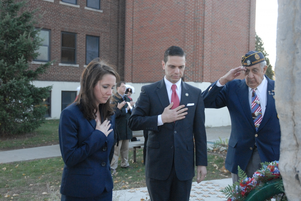 Assemblyman Angelo Santabarbara and  Amy Amoroso, a veterans business advisor at the University at Albany, present a wreath at the Rotterdam Veterans Day ceremony.