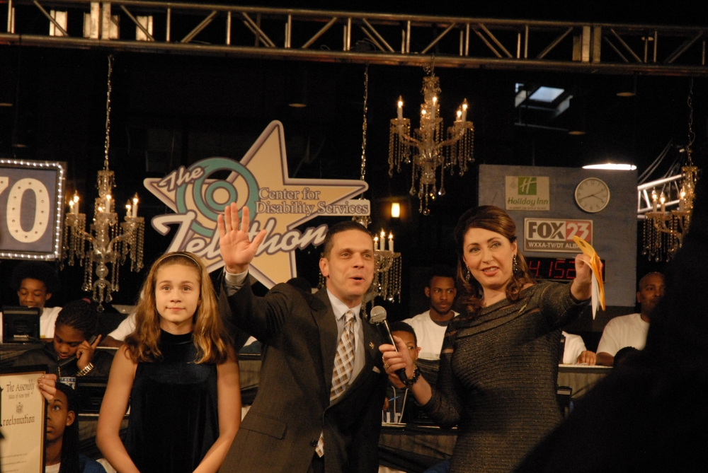 Assemblyman Angelo Santabarbara and his daughter, Marianna, join television news anchor Lydia Kulbida for the Center for Disability Services' Annual Telethon.  January 25, 2015