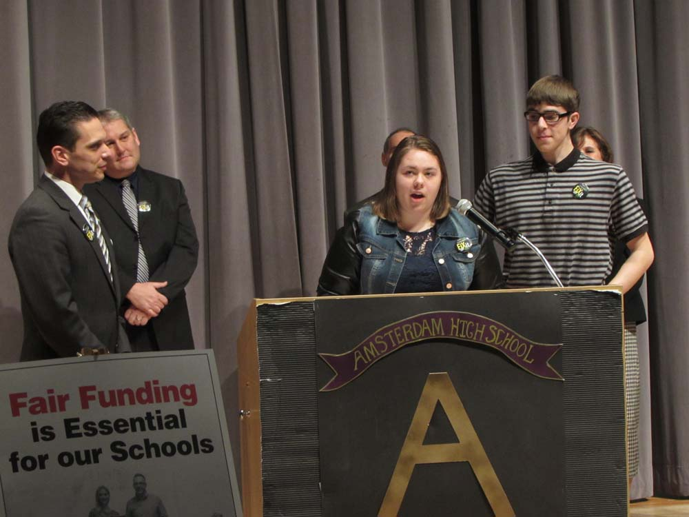 Fort Plain High School seniors Brianna Swartz (center) and Travis Herringshaw (right) join Assemblyman Santabarbara (left) in calling for fair funding for New York's public schools.