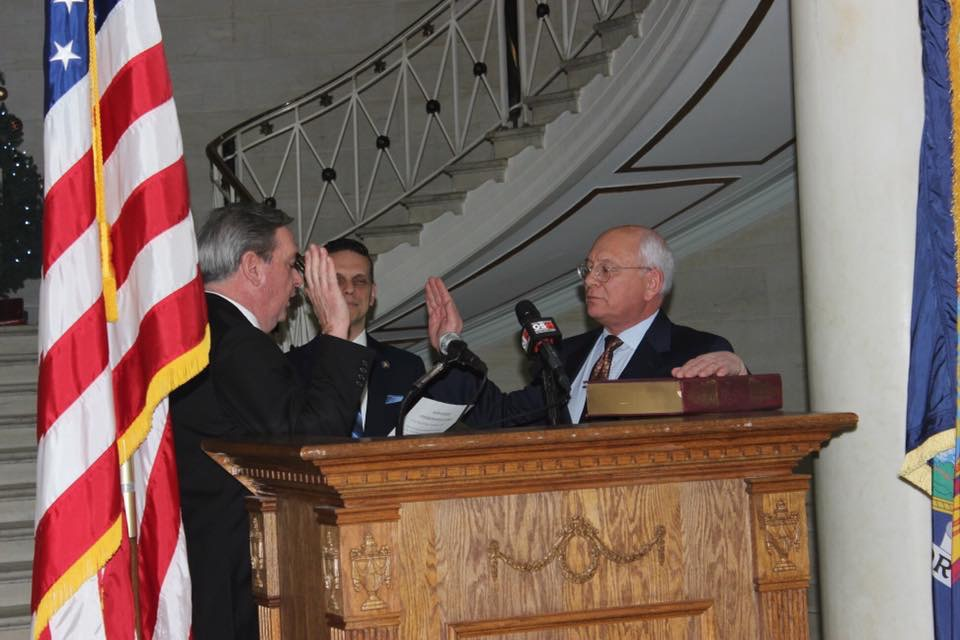 Congressman Paul Tonko is sworn in by Schenectady City Mayor Gary McCarthy, as Assemblyman Angelo Santabarbara observes.