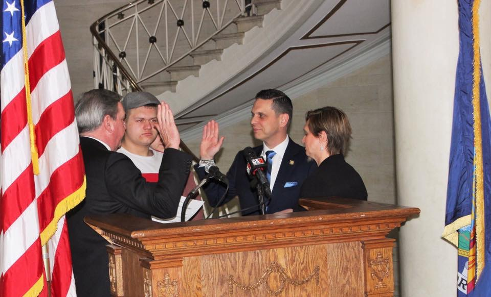 Assemblyman Angelo Santabarbara is sworn in by Schenectady City Mayor Gary McCarthy, as his son Michael and wife Jennifer looks on.