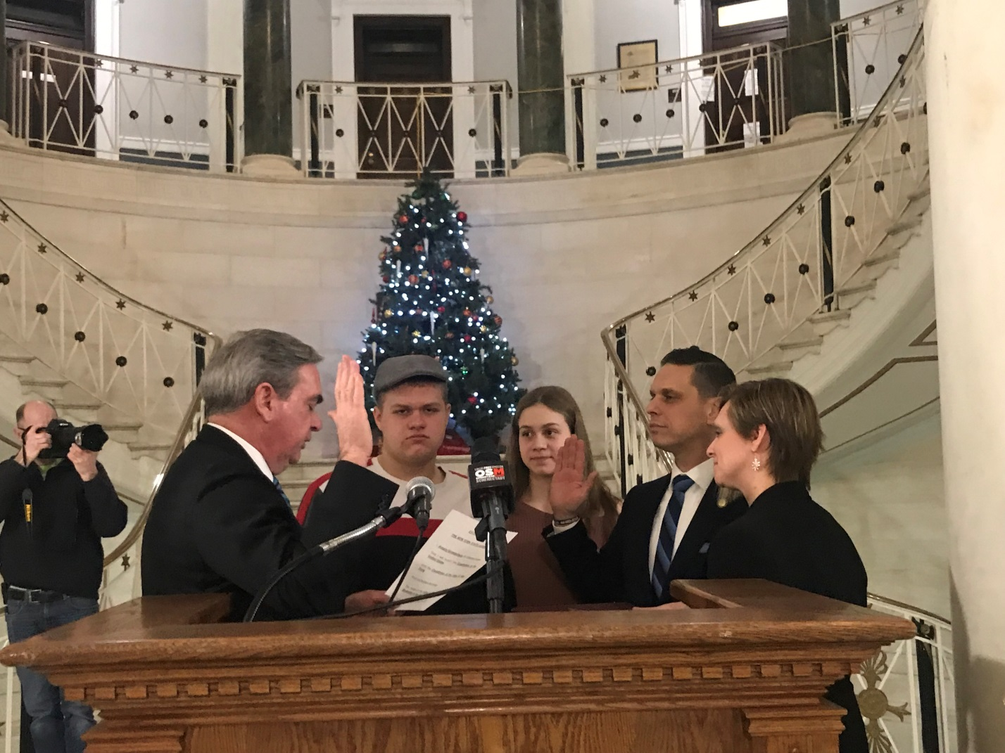 Assemblyman Angelo Santabarbara is sworn in by Schenectady City Mayor Gary McCarthy. From left to right is Mayor McCarthy, son Michael, daughter Marianna, Assemblyman Santabarbara, and wife Jennifer.