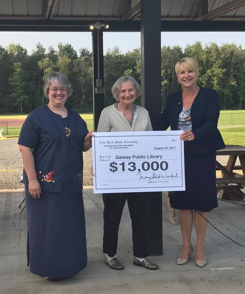 Assemblywoman Mary Beth Walsh (R,C,I,Ref-Ballston) presented a $13,000 contribution to support the Galway Public Library at a Community Ice Cream Social on Friday, August 25.   <br />
