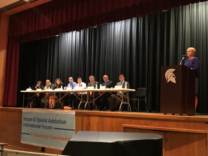 Assemblywoman Mary Beth Walsh (R,C,I,Ref-Ballston) offers welcoming remarks prior to an expert panel and discussion on heroin and opioid abuse. The community event was held on Wednesday, October 11 at the Burnt Hills-Ballston Lake High School.     <br />
