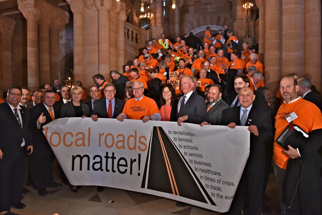 Assemblywoman Mary Beth Walsh (R,C,I,-Ballston)alongside highway workers on Wednesday, March 6.