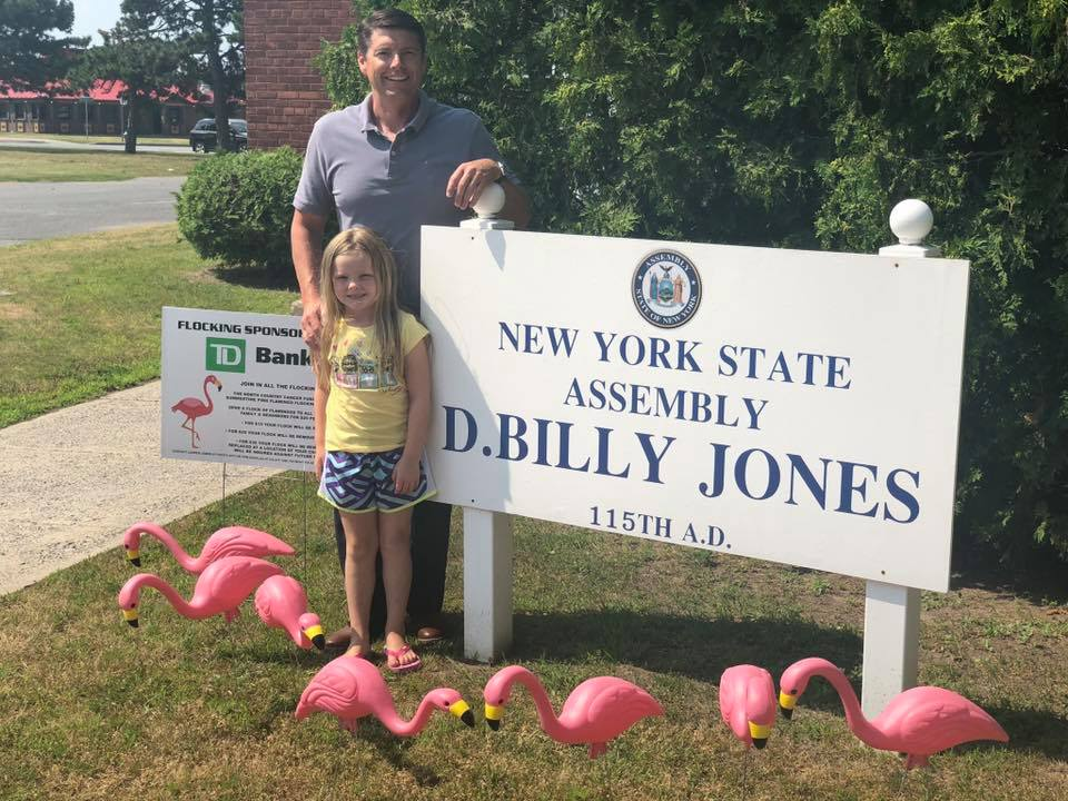 "Assemblyman Billy Jones' office was ""flocked"" by North Country Cancer Fund during their first annual Summertime Flamingo Flocking in July 2019. The ""flocking"" helps raise fund"