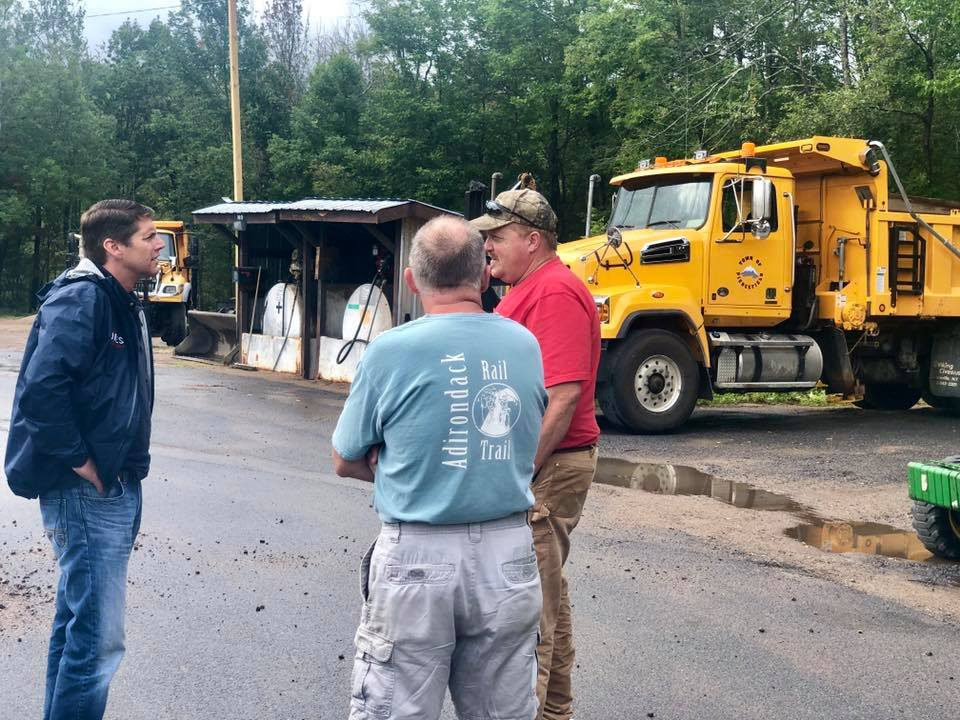 Assemblyman Billy Jones talks to Piercefield Highway Superintendent as part of his infrastructure tour in September 2019.