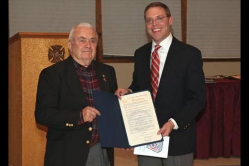 Assemblyman Will Barclay (R,C,I—Pulaski) recently presented Irving Candee, left, with a New York State Assembly Citation.  Candee has served the Belgium Cold Springs Fire Department for 60 years.  This occasion was recently celebrated at the fire department's annual installation banquet, held at Lakeside Fire Department Recreational Hall.  Candee has been a firefighter since Dec. 6, 1951.  During that time, he served as assistant fire chief, chief, secretary, and on the board of directors.