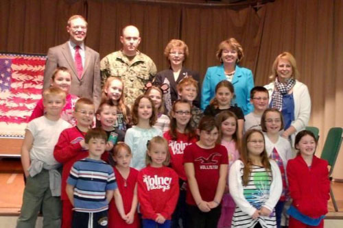 Students in Mrs. DeLisle's second grade class at Volney Elementary are pictured with, in back row, Assemblyman Will Barclay (R,C,I--Pulaski), Petty Officer and former student Eric Lockwood, County Legislator Linda Lockwood, Sen. Patty Ritchie and Mrs. DeLisle.