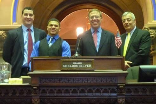 Baker High School Football Head Coach Carl Sanfilippo, Baker High student and Gatorade 2012-13 NY Football Player of the Year Tyler Rouse, Assemblyman Will Barclay and Baker High School Athletic Director Chris Campoleta on the Assembly floor.