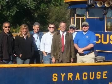Pictured, left to right, Ambrose Barbuto, Western Division Canal Engineer, NYS Canal Corporation; Janet DeOrdio, Civil Engineer, NYS Canal Corporation; Dave Beebe, Executive Director, Camillus Erie Canal Park; Shane Mahar, Deputy PIO, NYS Thruway/Canals; Assemblyman Will Barclay; John Joyce, Director of Special Projects, NYS Canal Corporation; and John Callaghan, Deputy Director, NYS Canal Corporation.