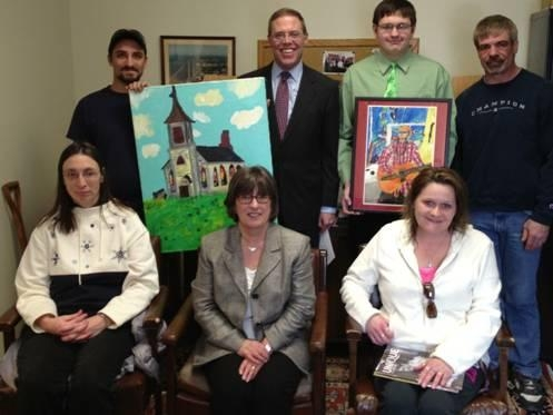 Assemblyman Will Barclay (R,C,I—Pulaski) recently met with featured artists who are part of the latest issue of Unique, a magazine which is published annually to display the creative work of people with disabilities living in Central New York in conjunction with ARISE. ARISE is an independent living center which is run by and for people with disabilities. Barclay has several pieces of art on display outside his office, which is located on the second floor of the County Building in Fulton. Pictured from left, in front row, are Tina Webster, Director of Oswego ARISE Sabine Ingerson, and Carrie Hart. In back row, from left, are Josh Webster, Assemblyman Barclay, Joseph Lisi, and Richard Lisi.