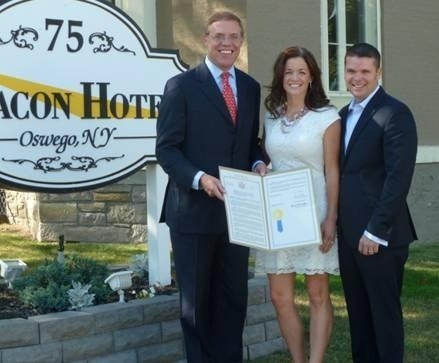 Assemblyman Barclay, left, presented Atom and Falecia Avery with an Assembly resolution. The couple was awarded a Small Business Excellence Award for the Beacon Hotel.