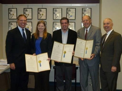 "Assemblymen Barclay and Oaks presented WRVO with State Assembly resolutions for receiving the Edward R. Murrow award for their documentary ""New York in the World."" From the left are Assemblyman Barclay, WRVO News Director Catherine Loper, Senior Producer Mark Lavonier, General Manager Michael Amiegh, and Assemblyman Bob Oaks."