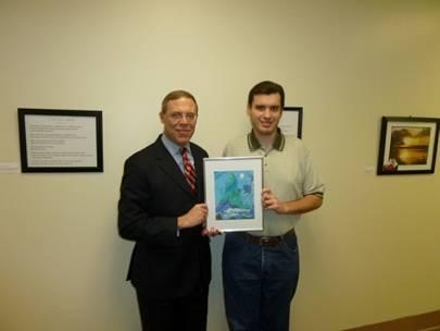 "Jeremy Kelley (right), holding his work titled ""Bald Mountain"" with Assemblyman Barclay."