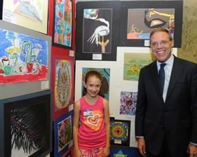 Julia Speich of Palmer Elementary School in Baldwinsville recently attended the New York State Art Teachers Association (NYSATA) Student Art exhibit in Albany.  Assemblyman Barclay is pictured with her at the exhibit.