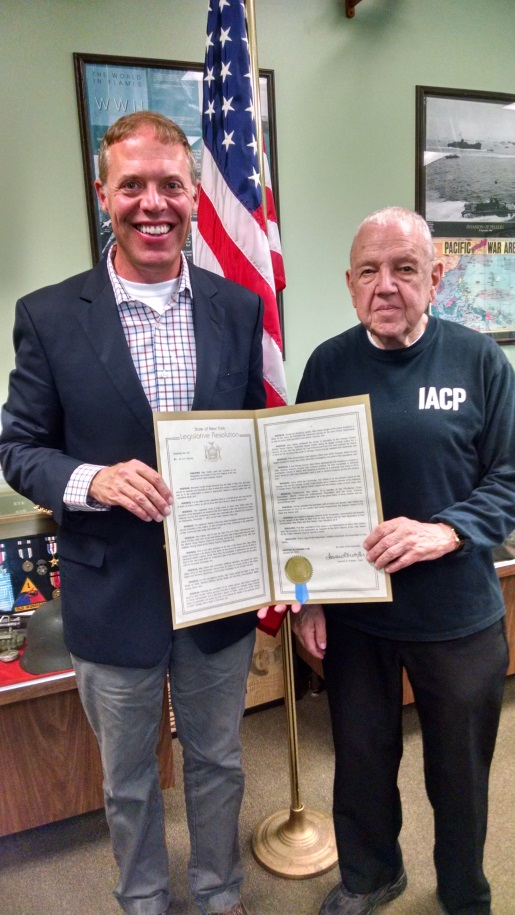 "Assemblyman Will Barclay presented Alan ""Dick"" Deline, right, with an Assembly Resolution commending his military service.<br />Assemblyman Will Barclay (R,C,I--Pulaski) recently presented an Assembly Resolution to Alan ""Dick"" Deline of Fulton, who was honored as the 2016 Veteran of the Year by the Fulton Veterans Council. Earlier this year, the New York State Assembly unanimously passed the resolution (K916) honoring Deline for his military service and for his service to his community after being discharged.<br />"
