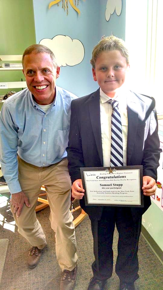 Samuel Stupp of West Monroe pictured with Assemblyman Barclay was the first reader this year to turn in his completed summer reading challenge.<br />