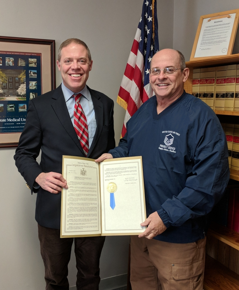 "Assemblyman Will Barclay (R,C,I,Ref--Pulaski) recently presented Fulton resident and Fulton Common Councilor Larry Macner with an Assembly Resolution honoring him for being selected as the 2017 Veteran of the Year by the Fulton Veterans Council.  Barclay said he was pleased to honor Mr. Macner with the resolution, which passed the State Assembly last year.  The resolution, which was presented to Mr. Macner in December at a local veterans' event, details his service to his country and his community.  Mr. Macner served in the U.S. Air Force which included 6 years of active duty.  Following his service in the Air Force, he served in the New York Air National Guard.  Throughout his career, Mr. Macner earned several medals and many service ribbons.  In 2016, he was inducted into the New York State Senate Veteran's Hall of Fame.  The resolution can be viewed at <a href=""/leg/?default_fld=&leg_video=&bn=K00486&term=&Summary=Y&Actions=Y&Memo=Y&Text=Y"""">http://bit.ly/2BemF2c</a>."