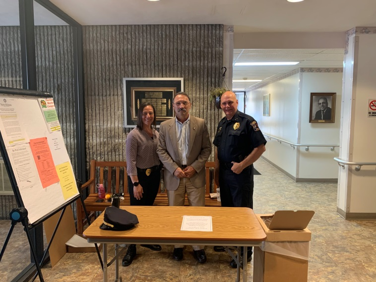 Assemblyman John Salka (R,C,Ref-Brookfield) alongside Oneonta Police Chief Doug Brenner and Detective Jennifer Torres on their joint prescription drug-take back event on Monday, July 8.