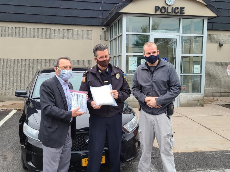 Assemblyman John Salka (R,C,Ref-Brookfield ) provides masks to Police Chief Paul Thompson of the Oneida Police Department on Friday, May 1.