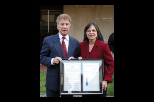 October 11, 2011 – Assemblywoman Donna Lupardo presents Dr. Sandro Sticca from the Abruzzese Social Club with a resolution commemorating the 150th anniversary of the unification of Italy at the Columbus Day flag raising ceremony in Binghamton.