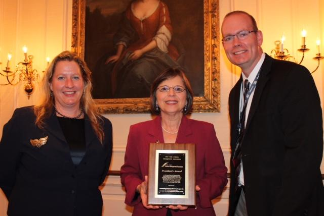 September 19, 2013 – New York Aviation Management Association President Ann Crook and Board of Directors Member Carl Beardsley present Assemblywoman Donna Lupardo with the 2013 NYAMA President's Award.