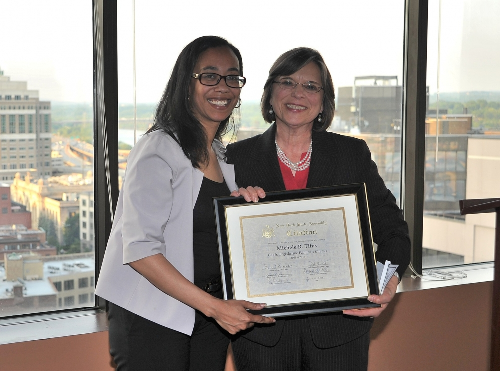 June 10, 2015 – Newly elected Chair of the Legislative Women's Caucus, Assemblywoman Lupardo, presents outgoing Chair Assemblywoman Michelle Titus with a citation in honor of her work and dedication to the Caucus.