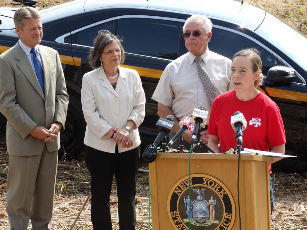 August 31, 2015 – Assemblywoman Lupardo joins Senator Pat Gallivan and Assemblyman Cliff Crouch as fallen State Trooper Christopher Skinner's sister Julie offers remarks at the dedication of two bridges named in her brother's memory.