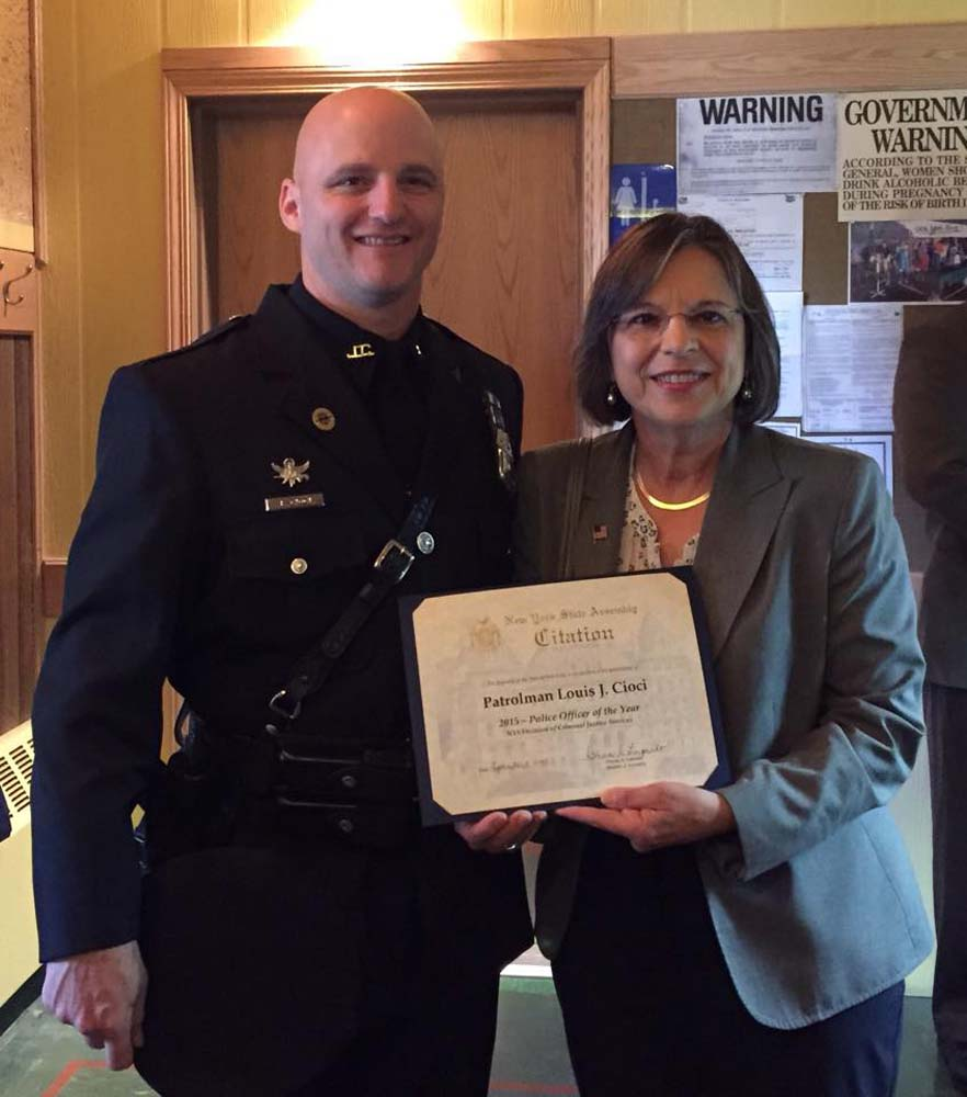 September 1, 2015 – Assemblywoman Lupardo presents Johnson City Patrolman Louis Cioci with an Assembly Citation at a ceremony honoring Cioci as New York State Patrolman of the Year.
