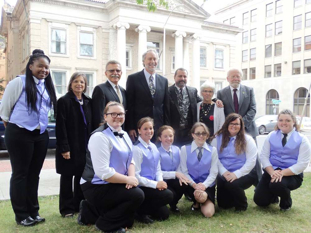 September 29, 2016 – Assemblywoman Lupardo, SUNY Broome officials, and Hospitality School students in front of the college's new Culinary Arts Center. Lupardo secured a $5 million appropriation in the State Budget that will help preserve the historic Carnegie Library that will be home to the new school.<br />