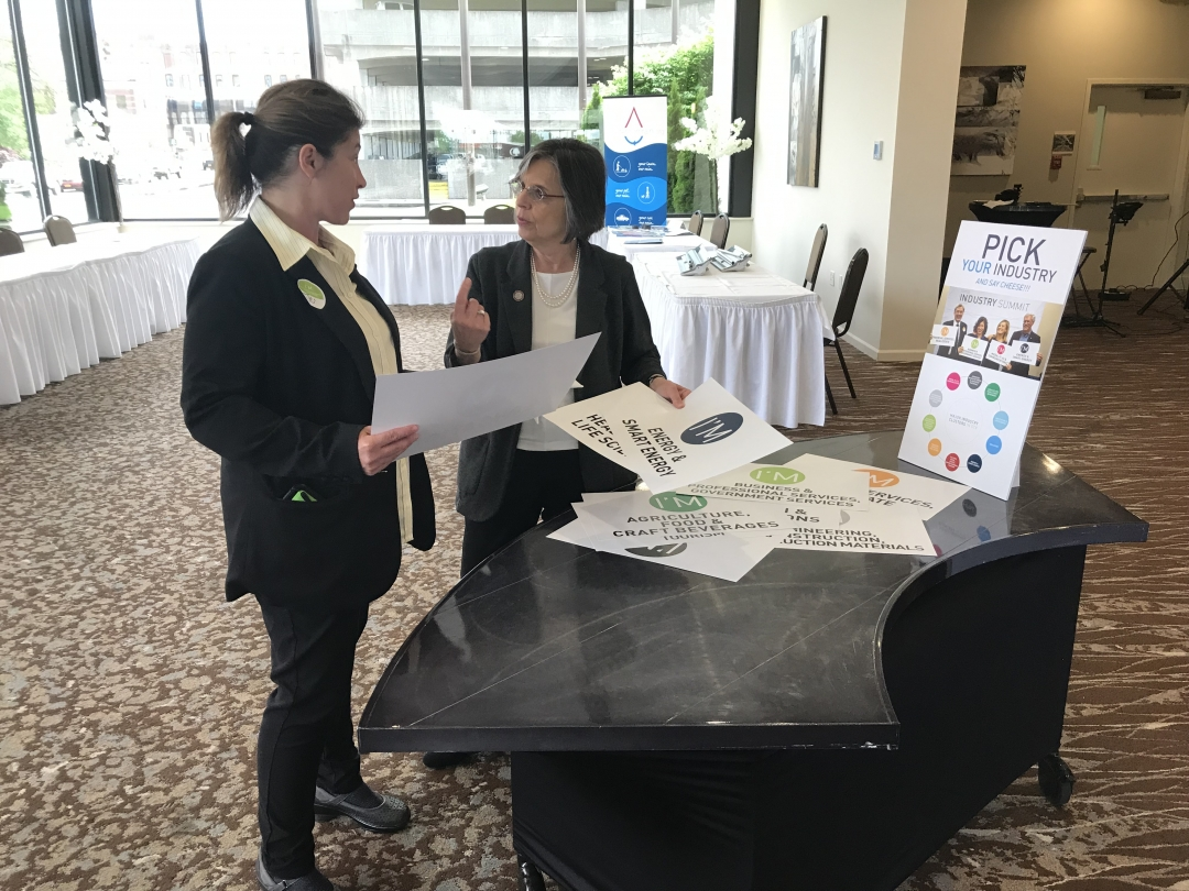May 23, 2019 – Assemblywoman Lupardo speaks with Jen Gregory of Southern Tier 8 during the group's industrial summit on food and agriculture.