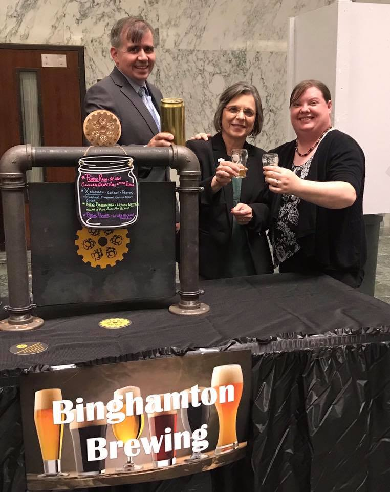 May 21, 2019 – Kristen Lyons and Jason Gardner, owners of Binghamton Brewing Co., raise a glass with Assemblywoman Lupardo during the NYS Brewers' Association event at the Capitol.