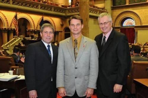 Pictured, left to right, Jay Dinga, Assemblyman Chris Friend, Thomas Osiecki