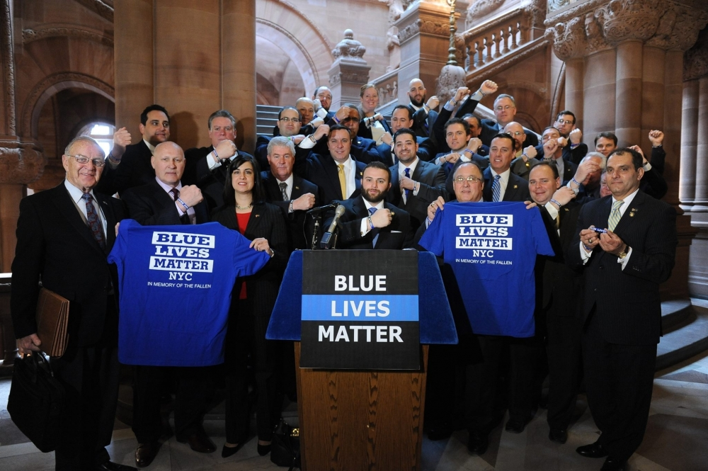 Members of the Assembly Minority Conference and representatives from Blue Lives Matter at a press conference showcasing their Blue Lives Matter wristbands.