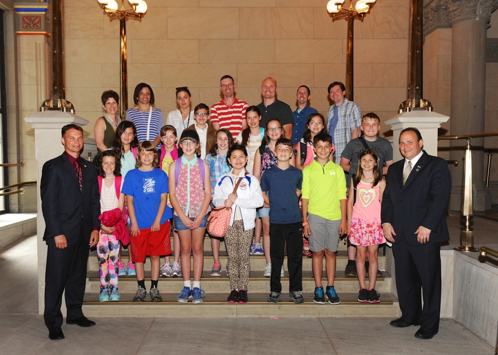 Assemblymen Christopher S. Friend (R,C,I-Big Flats) (bottom, left) and Phil Palmesano (R,C,I-Corning) (bottom, right) recently welcomed the Southern Tier Montessori School to the Capitol and the Assembly Floor. The students spent the day learning how state government operates and the role it plays in the day-to-day operations of the state. Pictured here, first row (left to right), Allison Giaconia, Conrad West, Caitlyn O'Dell, Emily Nguyen, Aaron Verkleeren, Liam Bayne, and Abiey Kohnke. Second row, Alina Levine, Kateri Condon, Charly Slusser, Clara Campbell, Hannah Masaki, and Sean Thweatt. Third row, Gavin DeLuca, and Reina Powers. Back row, Sheila Reed, Michele Johnson, Deborah Thweatt, Glenn Kohnke, David Slusser, Cory West, and Richard Condon.
