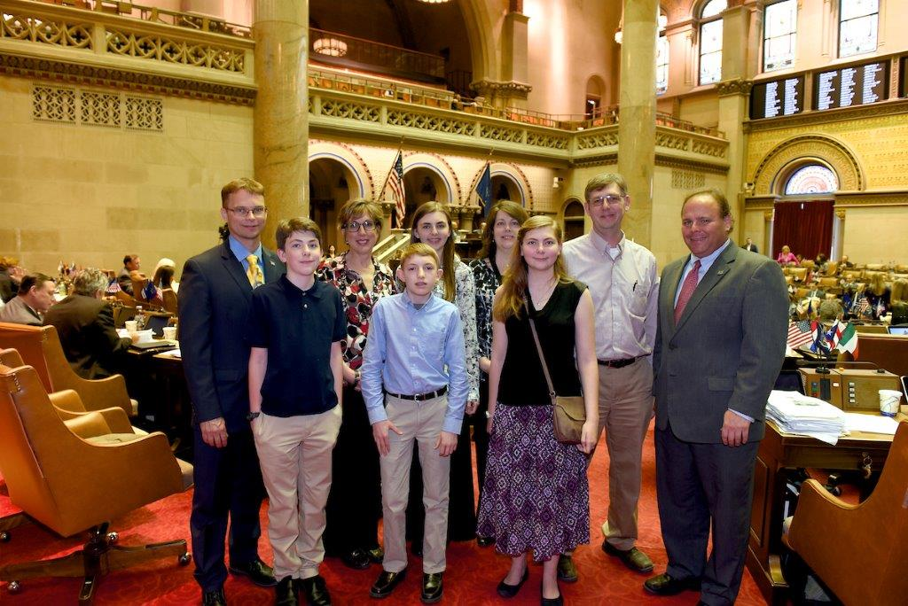 Assemblyman Christopher S. Friend (R,C,I-Big Flats), the Pawlak and Orcutt families and Assemblyman Phil Palmesano (R,C,I-Corning) in the Assembly Chamber.<br />