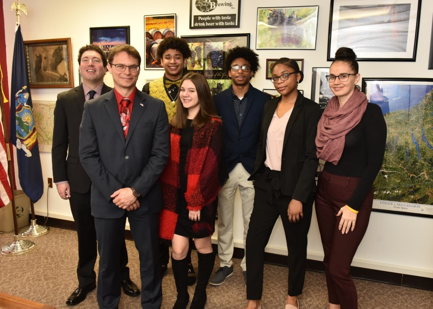 (Left to right)  Counselor Nick Matyas, Assemblyman Christopher Friend (R,C,I-Big Flats), Xymier Thomas, Madison Oliveri, Kaelin Thomas, Ruby Moncrieft and Counselor Autumn Loke meet to discuss the Bi
