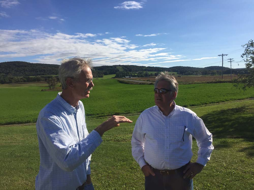 Michael Ward, of Field House Farms in Fabius, (left) and Assemblyman Stirpe discuss beef farming and local issues.