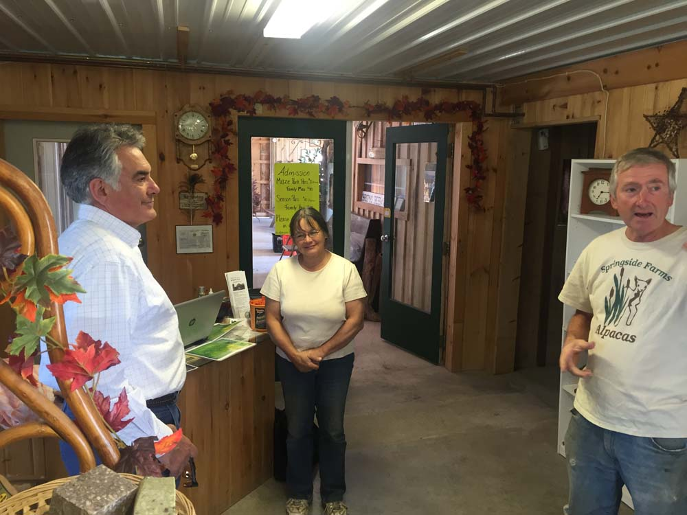 Ed and Paulie Drexler show Assemblyman Stirpe around Springside Farm, an agri-tourism farm located in Fabius.