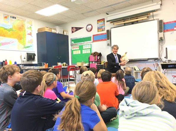 Assemblyman Al Stirpe visited all six schools in the Fayetteville-Manlius School District recently. Here he is reading to a class at Fayetteville Elementary.