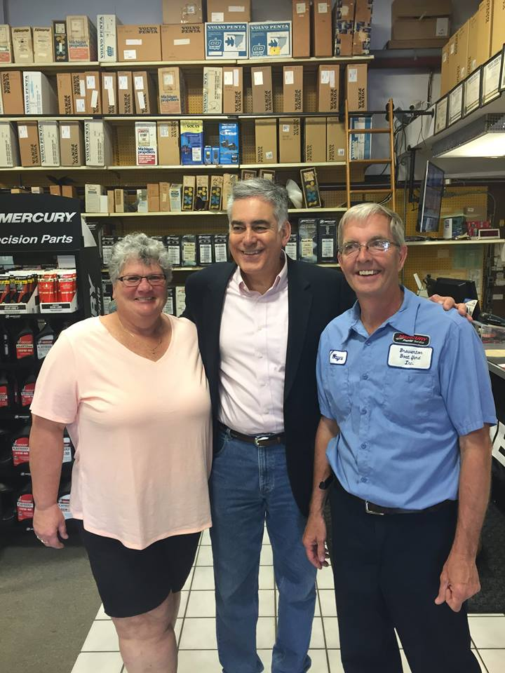 Assemblyman Stirpe talks with Wayne and Helen Carroll of Brewerton Boatyard, Inc.
