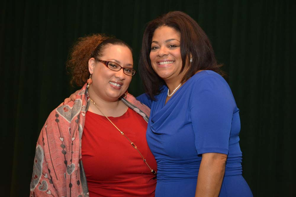 Tamar Smithers, Director of Education at Community Folk Art Center and Assemblymember Pamela J. Hunter at her swearing in which took place at Le Moyne College on December 29, 2015.