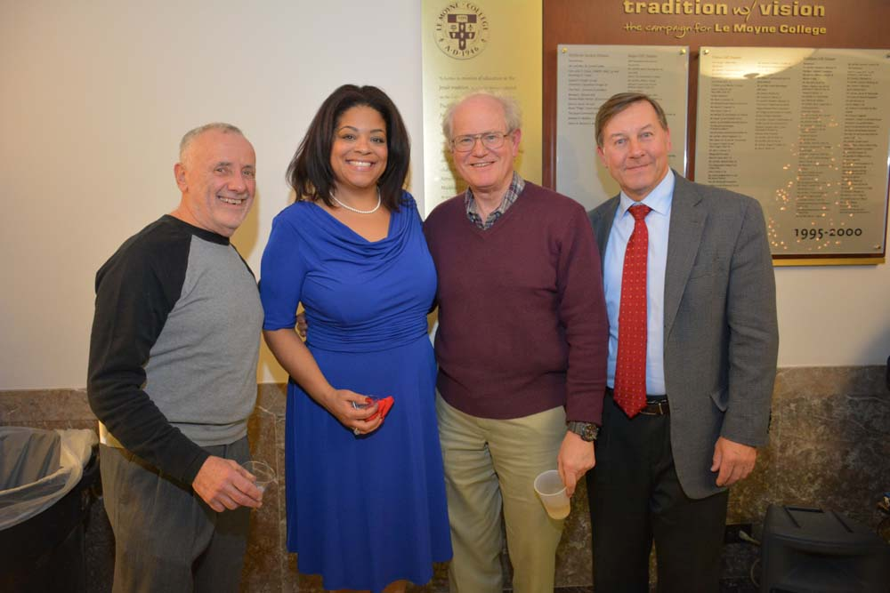 Bruce Block, Bill Delavan, President of the Delavan Center & Steve Kulick, Director of Corporate, Foundation and Government Relations at Le Moyne College congratulate Assemblymember Pamela J. Hunter at her swearing-in at Lemoyne College on December 29, 2015
