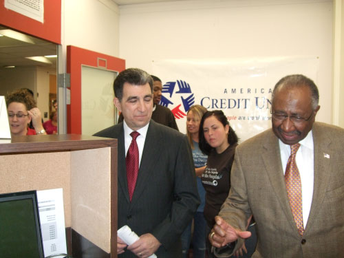 "Assemblyman Magnarelli and City Council President Van B. Robinson take a tour of ""Falcon Trust,"" the new community credit union at Fowler High School. The branch will be operated by students, in partnership with Cooperative Federal."