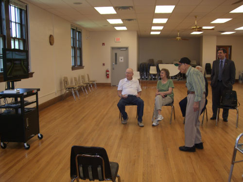 Joe Fielding, Carol Carl, Ray Perkins, and Assemblyman Magnarelli watch Joe Papaianni use the new Wii system at the Bob Cecile Community Center. The center purchased the gaming system, and other supplies, with a grant the Assemblyman secured to help the senior citizens stay active and engaged.