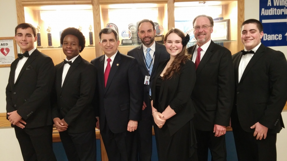 Assemblyman Magnarelli, Superintendent Dr. Chris Brown, and Director of Fine Arts Bill Davern posed with high school band members prior to the concert.<br />